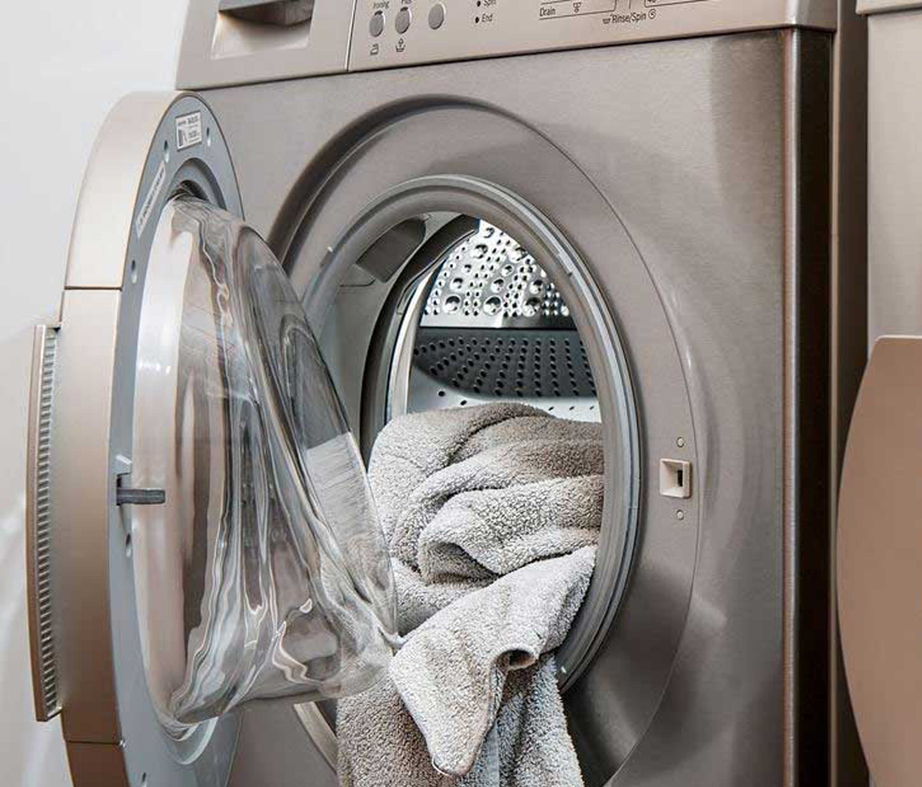 washing machine with a towel coming out