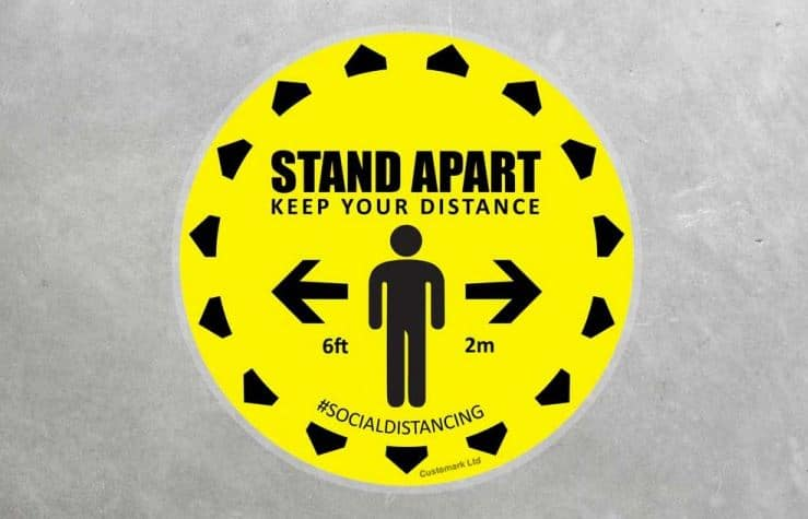 standing 2m apart social distancing floor sticker in yellow